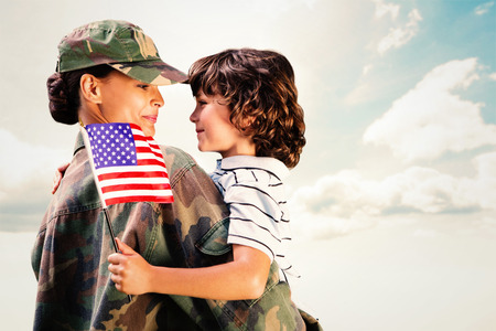 Veteran holding child with American flag